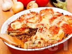 Патладжанова мусака с телешка кайма и заливка от сирене моцарела - снимка на рецептата